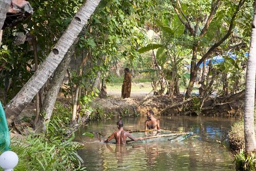 fishermen fisherman fish fishing canal stream backwaters kerala india munroe island water brackish net nets coconut palms men bamboo pole woman man hairy munrothuruthu