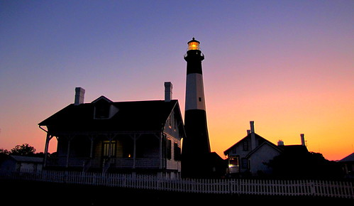 lighthouse sunset dusk fence house sky