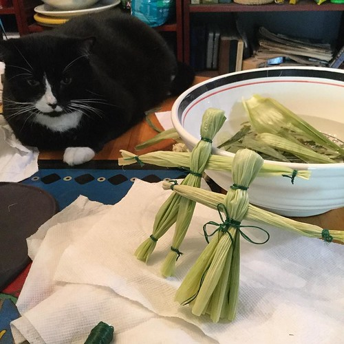 My corn husk god and goddess are ready to be added to my Lughnasadh altar. I'll do a little blessing first. 🌾 My helper Merlin was on hand to oversee the creative process😻 🌽 I have a few corn husks still soaking, so will sa | by innerjourneyevents