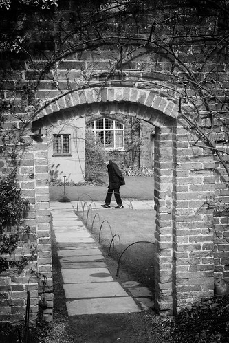 england warwickshire packwoodhouse nationaltrust garden doorway wall path walking woman plants windows bw