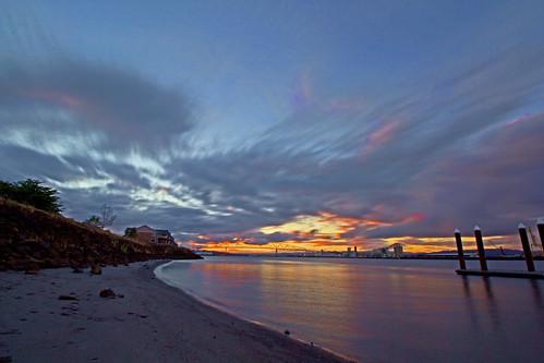 rainieroregon columbiariver rainierriverfrontpark oregon water beach sunset clouds