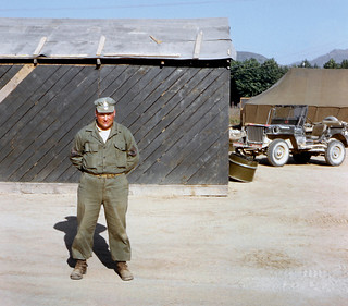 Korea scene with Dad (Sergeant First Class) seen standing in front of an U.S. Army structure, in the early 1950's