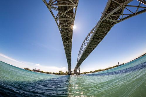bridge sky sun water us unitedstates michigan fisheye shore bluewaterbridge porthuron canoneos5dmk3 rokinon12mmf28fisheye