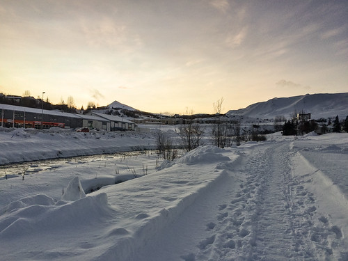 iphone footprints landscape winter walking outdoor hills snow iceland travel akureyri sunset sky river commons path clouds mountain northeast is