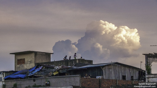 building buildings children city clouds decay phnompenh roof rooftop sky sunset urban cambodia