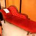 Dark wood ornate chaise longue