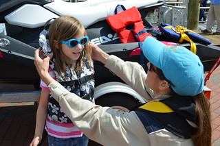 Photo of girl being fitted with life jacket