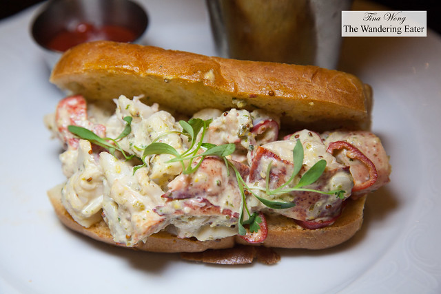 Lobster roll with melted butter, mayo, tarragon on buttered roll and side of fries