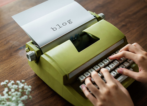 Aerial view of a man typing on a retro typewriter | by Rawpixel Ltd
