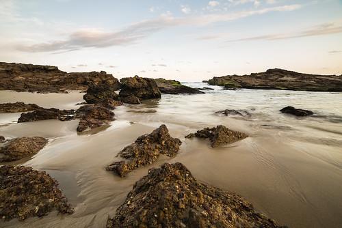 beach water ocean sea seascape rocks conglomerate seashore sky clouds colour goldenhour sunset color newsouthwales camdenhead crowdybaynationalpark sand nsw australia nikond750 samyang14mm