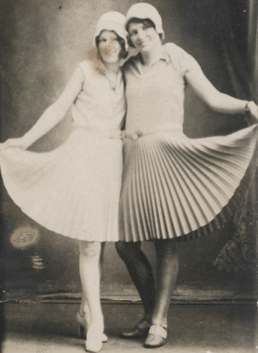 Two women in pleated skirts | by simpleinsomnia