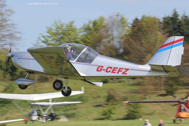 G-CEFZ - 2006 build Aerotechnik EV-97 Eurostar, departing from Popham during the 2014 Microlight Trade Fair