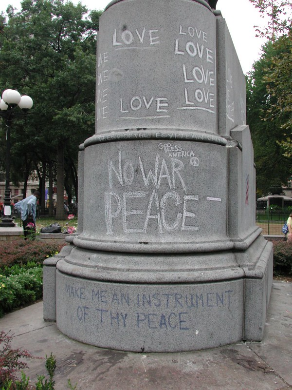 Anti-war graffiti on base of statue, Union Square Park, September 24, 2001