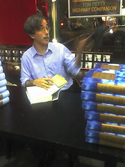 Gordon signing bunches of books | by Tanya R.