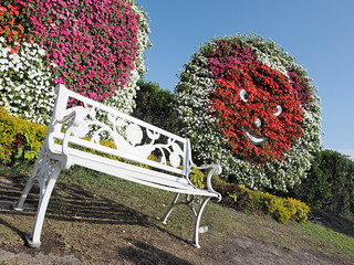 Great spot for photos. A white chair with big flowers smiley in the background.   by huislaw