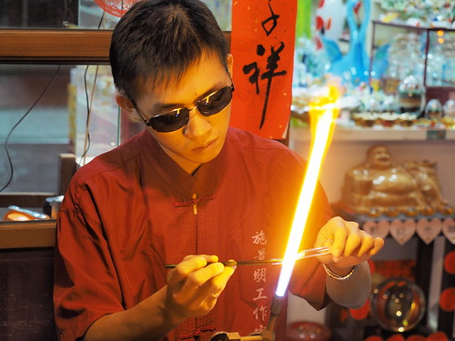 An artist working on glass arts.   by huislaw