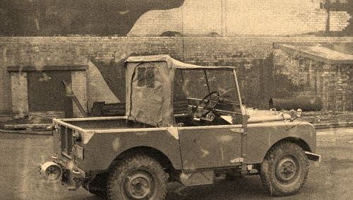 Land Rover Models : R01 outside camouflaged Rover factory.