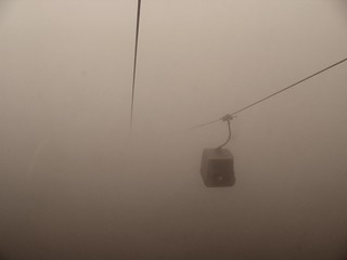 When reaching the Etna top station - the cable car is lost in mist