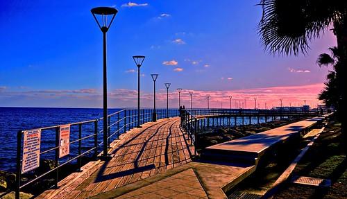 beautiful blue boardwalk city clouds colorful cyprus eu europe lights limassol mediterranean nyandreas pier pink sea serene shadow sky spectacular streetlights sunset trees water waterfront landscape seascape sony6000 travel shadows dusk evening afternoon waterway walkway
