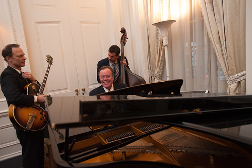 Bob Merrrill, AB '81 and his trio entertain guests at cocktails