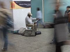 Guy playing a saw in subway