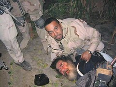 Samir holding Saddam