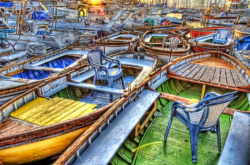 Chairs in Boats by Trey Ratcliff