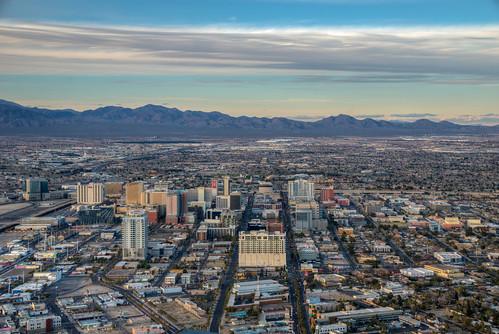 fremont street stratosphere las vegas nevada aerial skyline city cityscape mountain desert sunset fremontstreet lasvegas lasvegasnevada