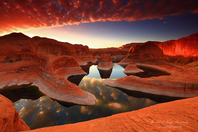 Sunrise Reflections in Reflection Canyon on Lake Powell in the Glen Canyon National Recreation Area in Utah