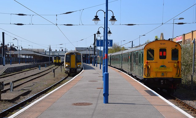 387 103 in the centre is departing Kings Lynn with the 13.55 service to Kings Cross, on the left is stabled 317 509, whilst Thumper Unit 1001 awaits a trip to Middleton Towers, part of the West Norfolk Wanderer Tour. 21 04 2018