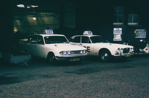 Triumph 2.8.PI UWS 102J and Jaguar RSG 235H,City of Edinburgh Police Traffic Dept. Brandon St. Garage circa 1971 | by landshark2084