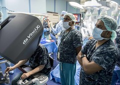 Surgical staff aboard USNS Mercy (T-AH 19) and a Sri Lankan surgical team perform the robot-assisted surgery using the Da Vinci XI Robot Surgical System, May 4. (U.S. Navy/MC2 Kelsey Adams)
