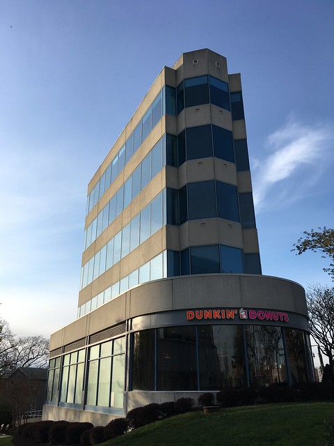 Wedge shaped office building with Dunkin' Donuts, Connecticut Ave. and River Rd. NW, Washington, D.C.