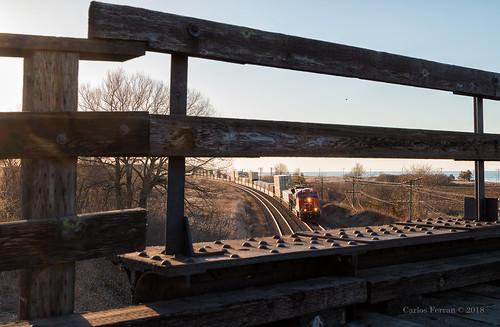 cn canadian national locomotive ontario canada lovekin on lakeshore lake views wooden bridge intermodal freight train trains ge et44ac loco rails rail road railroad sunrise rural