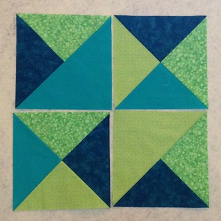 Assorted half and quarter square triangles for May Faith Circle of do.  Good Stitches