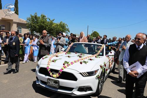 Satguru Mata Ji on flower bedecked open car
