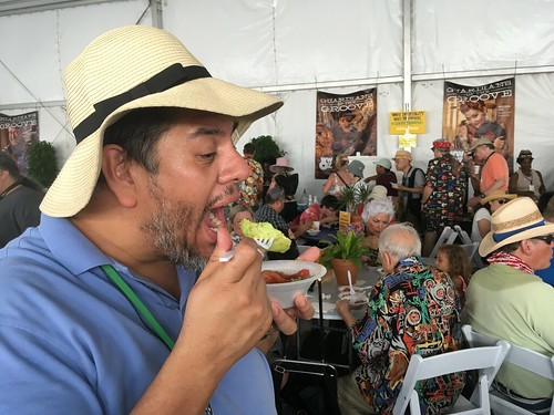 Jorge eats at Jazz Fest - Avocado Woo Woo - Sunday, May 6, 2018. Photo by Carrie Booher.