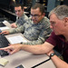 Capt. Seth Martin and 1st Lt.Joshua Mosby, Air Force Institute of Technology students, listen as Barry Mullins, AFIT computer engineering professor, explains a hacking technique they can use during their computer systems cyberattack class at Wright-Patterson Air Force Base, Ohio, Feb. 20, 2018. Counter insurgency hacking is an espionage attack weapon taught to deter enemy threats to national computer communication systems. (U.S. Air Force Photo by Al Bright/Released)