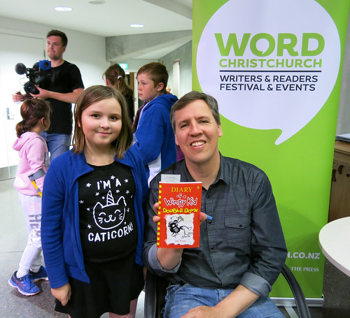 Jeff Kinney signs a book