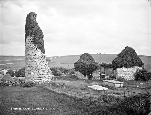 robertfrench williamlawrence lawrencecollection lawrencephotographicstudio thelawrencephotographcollection glassnegative nationallibraryofireland drumcliffe coclare clare roundtower church graves ruins hay haystacks munster drumcliff drumcliffchurch drumcliffroundtower tombs graveyard cemetery ivy summer
