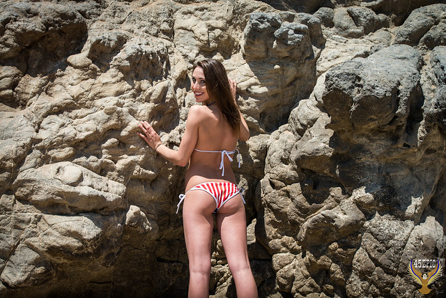 American Flag Bikini Surfer Girl! July Fourth USA Flag Bikini Independence Day Swimsuit Model in Malibu Sea cave! Pretty American Flag Swimsuit Bikini Model! Red White Blue USA Flag Swimsuit Model on Malibu Beach! Happy 4th of July! Stars Stripes Forever
