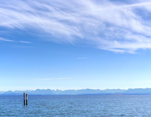 storiesbeachpark canada vancouverisland clouds mountains landscape seascape blue ladysmith piles pilings piers straitofgeorgia