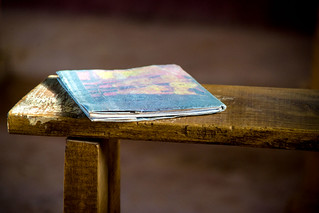 Notebook on a rustic wood bench in Kenya