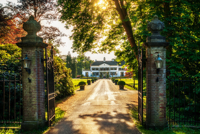 Castle Engelenburg in Brummen Gelderland in the warm evening sun of a Dutch summer night. This is really a lovely place to visit. With its greenery, and open lanes and white buildings.