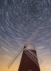 The windmill stands and sees
