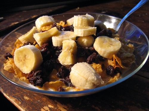 Cornflakes Topped With Bananas & Raisins.   by shutterberry