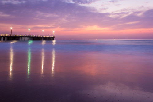 coast shore coastal water sea ocean clouds sky pier reflection longexposure lights
