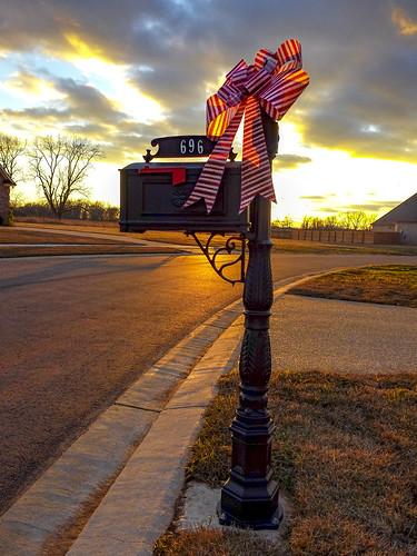 mailbox street louisiana bossier sunset bow winter cellphonephotography christmas goldenhour curb neighborhood clouds