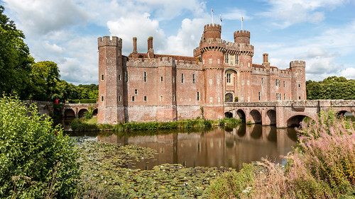 herstmonceux castle brick moat bridge tower fort sussex photomerge panorama water lily tree bush willowherb reflection landscape flag redphonebox sky building architecture
