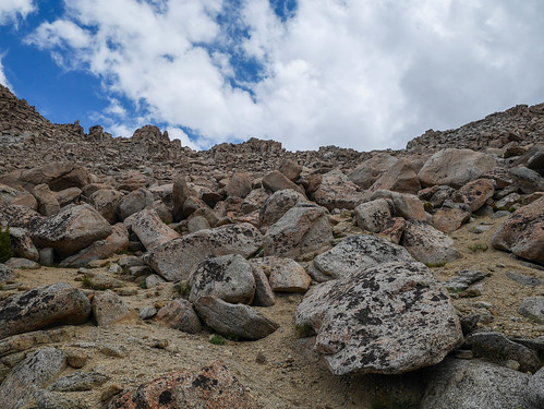 Looking back up at Lamarck Col. The proper col is at rightmost 90 degree angle in the ridgeline, where the ridgeline is relatively straight then bends straight up a small cliff, it's being pointed to here by a triangle rock in the middle foreground | by snackronym
